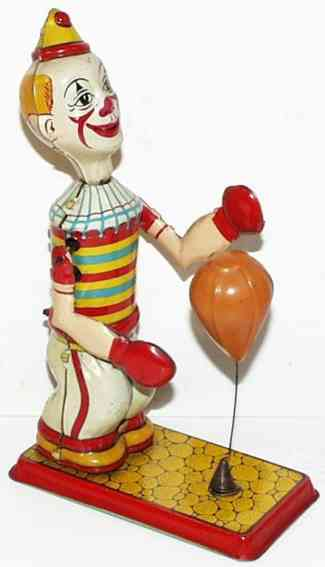 chein co tin toy clown bag puncher wind up