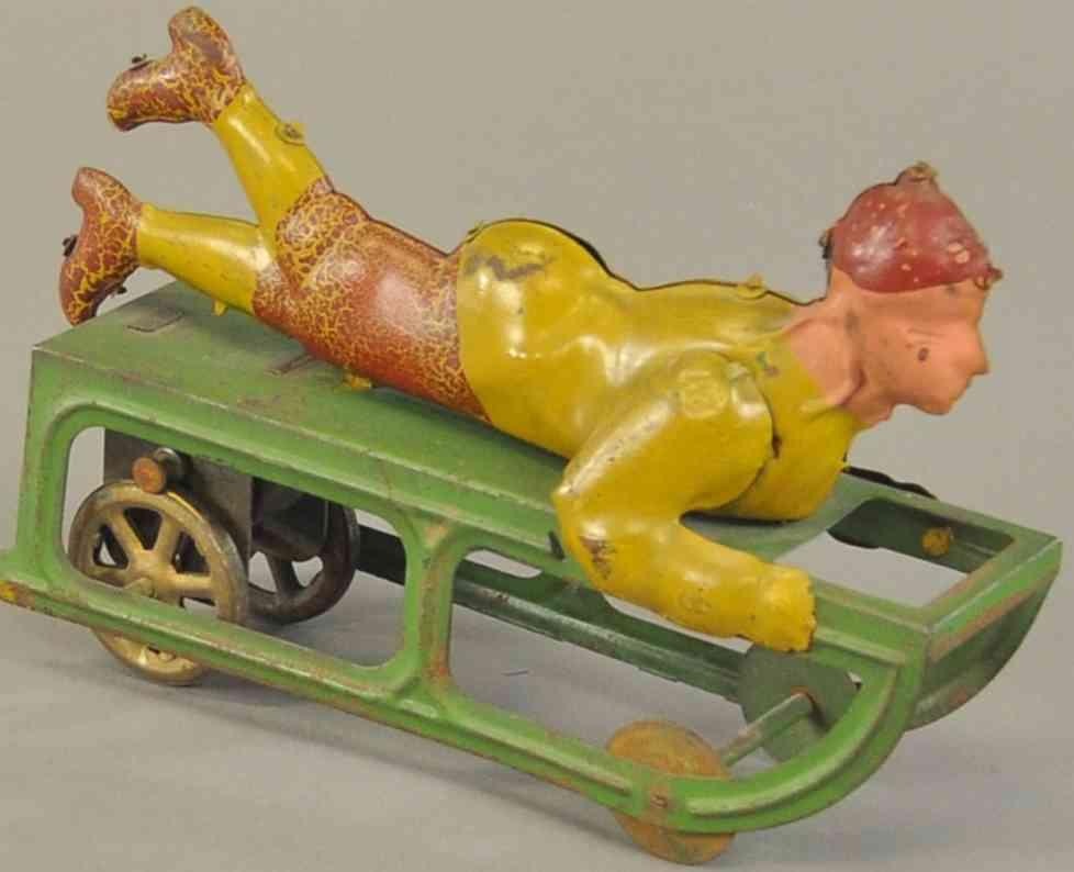 dayton  pressed steel toy boy on sled friction drive