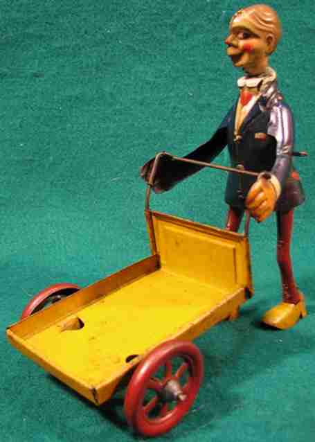 distler johann 573/1 tin toy comical man carrying a trolley