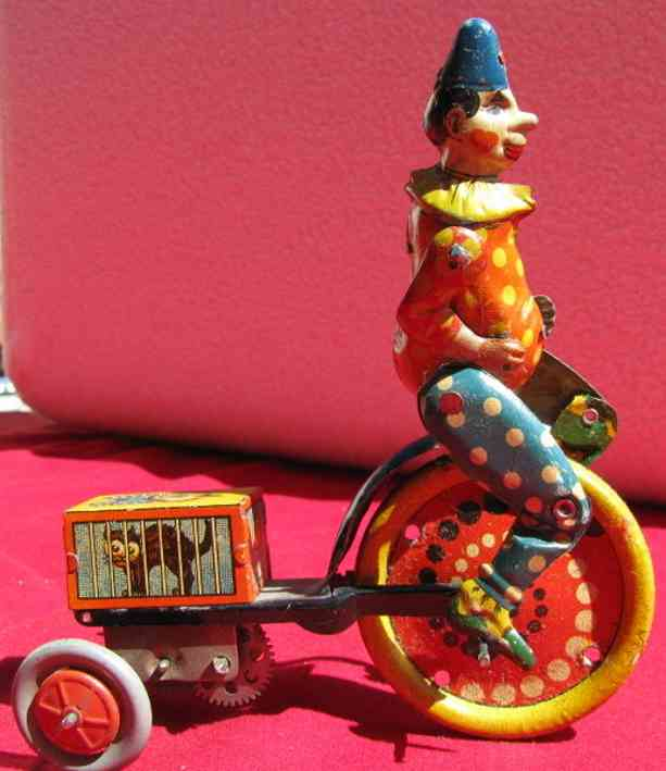 distler johann tin clown with tricycle and black cat wind-up toy