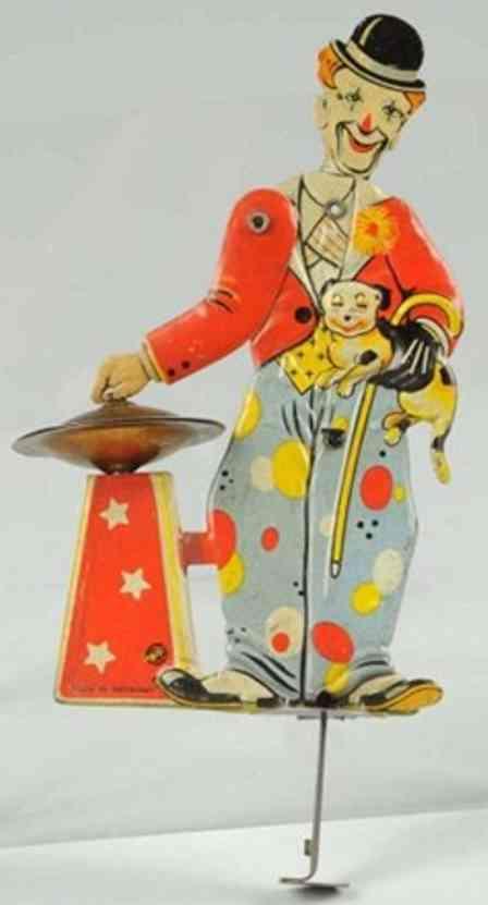 distler tin toy clown sparkler type with plunge mechanism