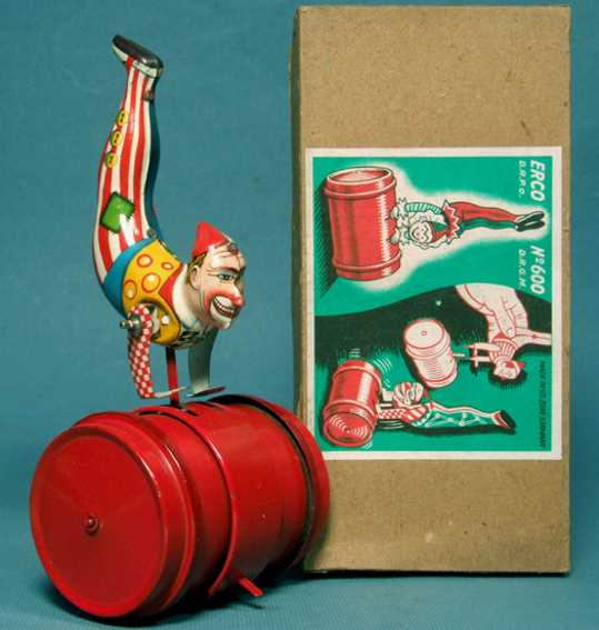ERCO 600  Circus clown acrobat balancing on a barrel with clockwork of tin