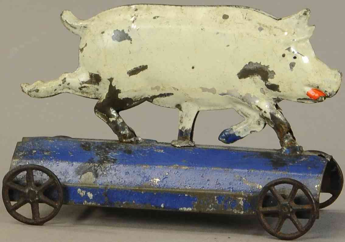 fallows tin toy pig in white on blue platform