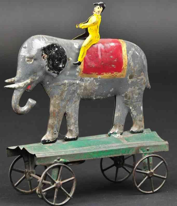 fallows blech elefant mit reiter als ziehspielzeug,