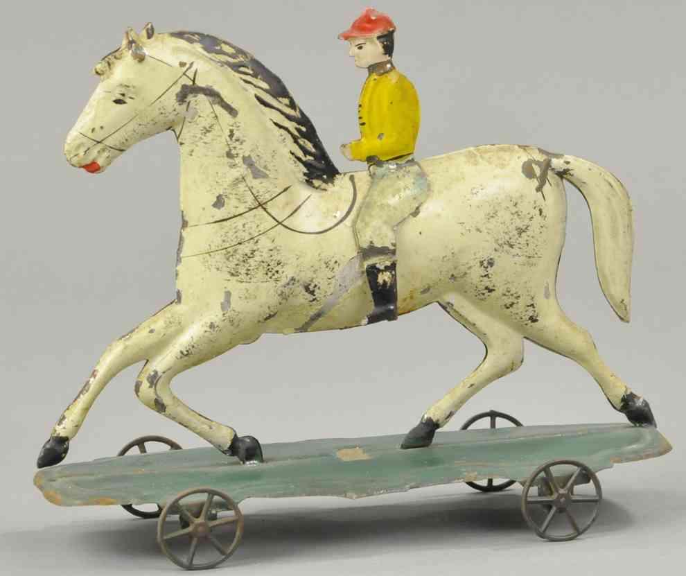 fallows blech spielzeug jockey auf pferd auf plattform