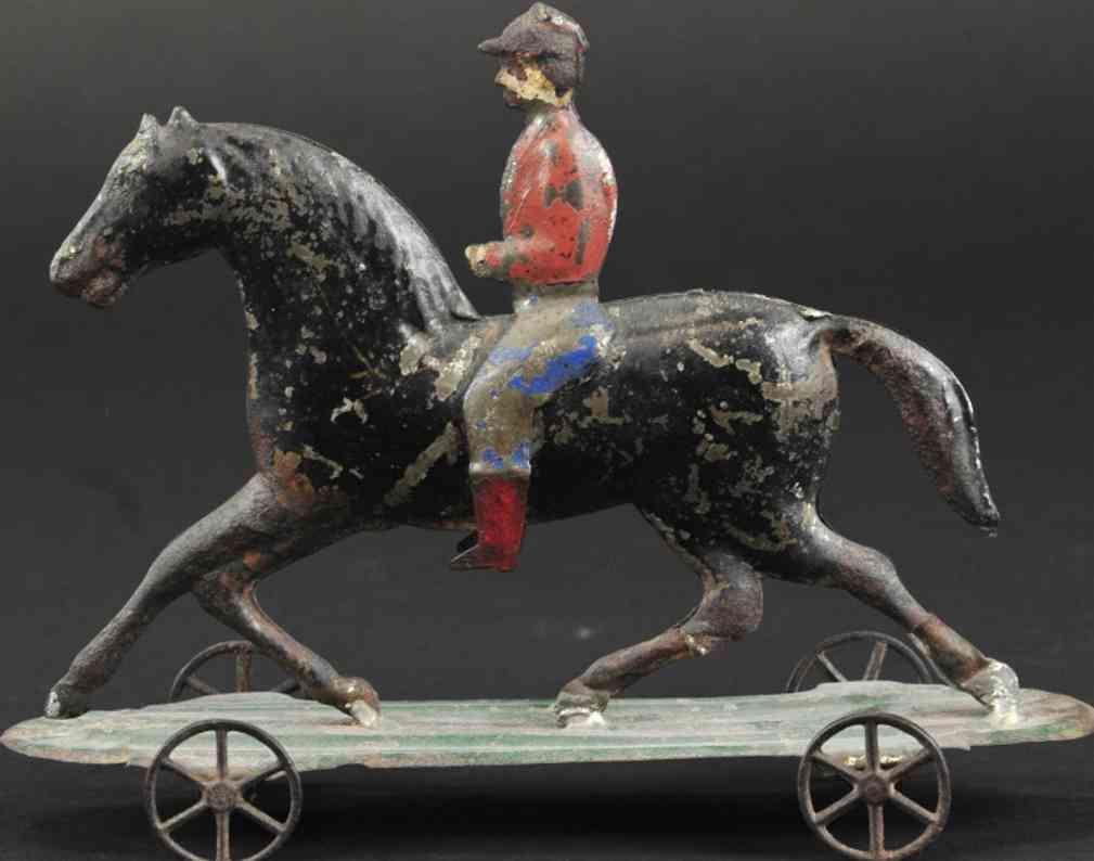 fallows blech reiter auf pferd als ziehspielzeug