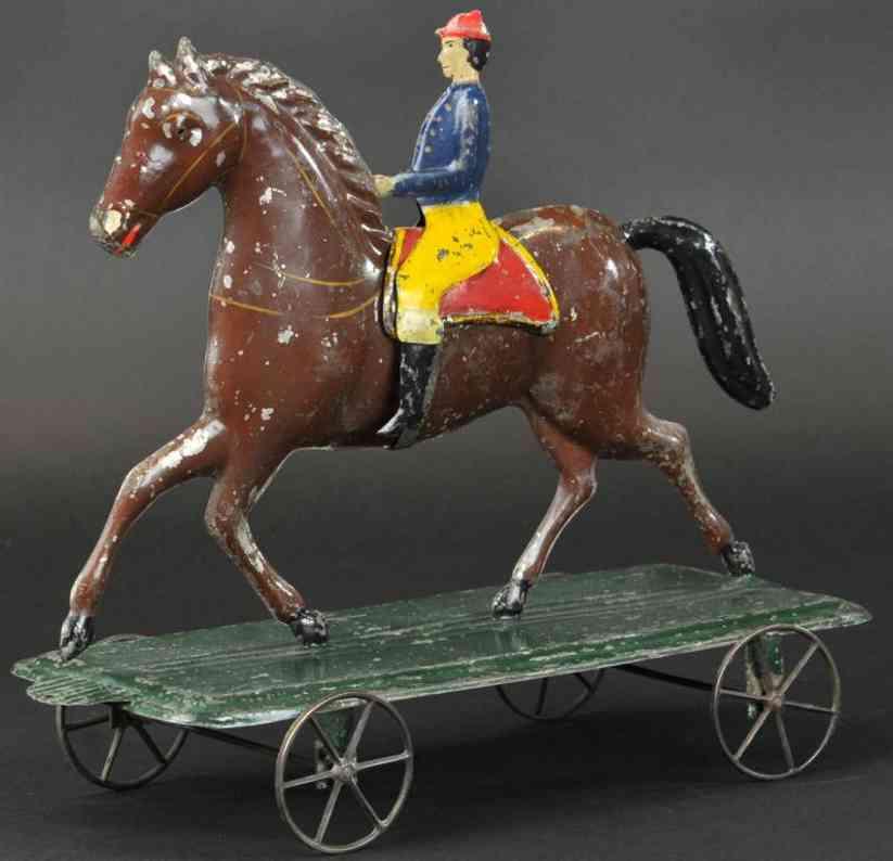 fallows tin toy jockey horse wheeled platform