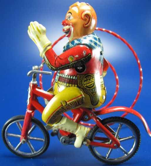gescha blech spielzeug clown rodeo clown auf fahrrad mit uhrwerk, gummireifen, das antrie