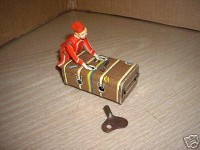 gescha 57-1 blech spielzeug liftboy mit uhrwerk rot blau