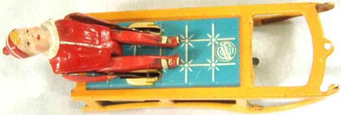 gescha 57/3 tin toy bobsled boy on sledge clockwork