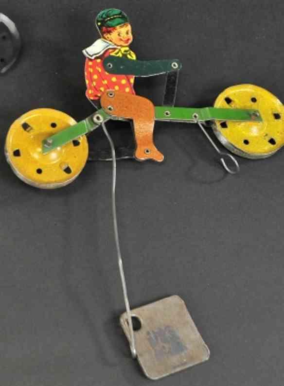 gilbert blech spielzeug junge auf fahrrad fuer seilfahrt