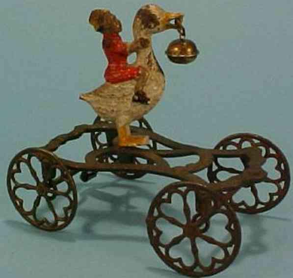 gong bell 58 cast iron toy goose with rider black child clockwork bell