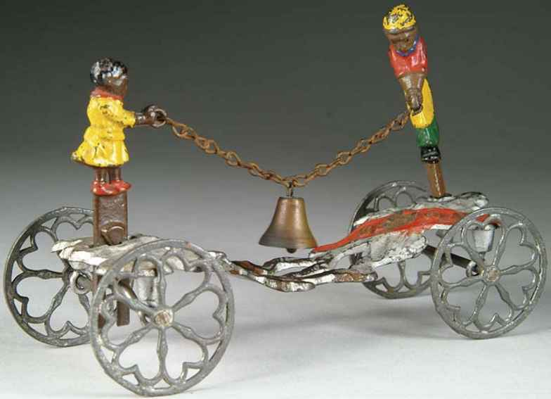 gong bell 59 cast iron toy rastus and his mother