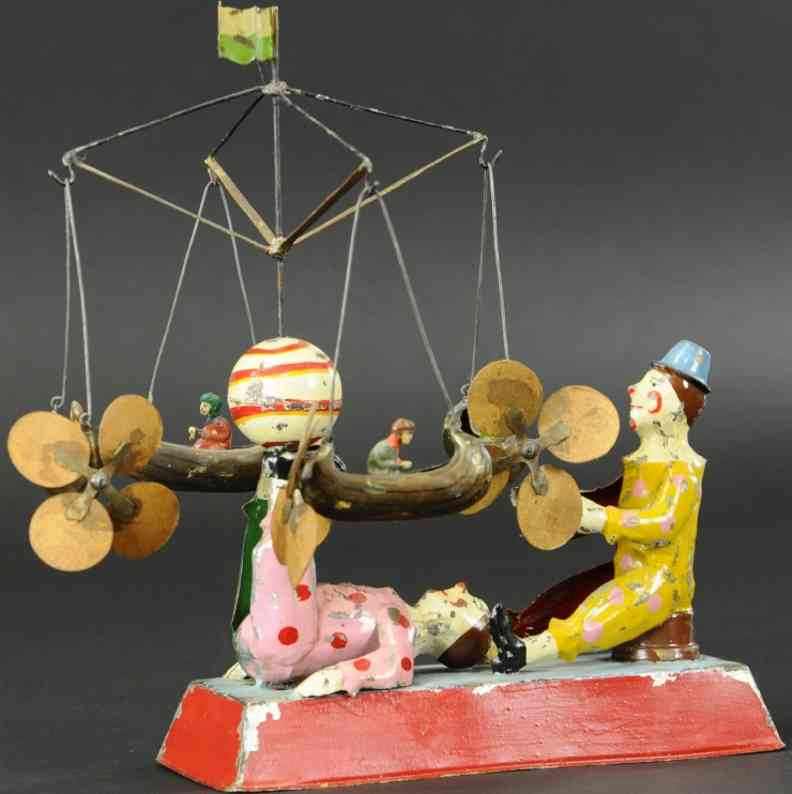 gunthermann tin toy two performing clowns with four flying boats