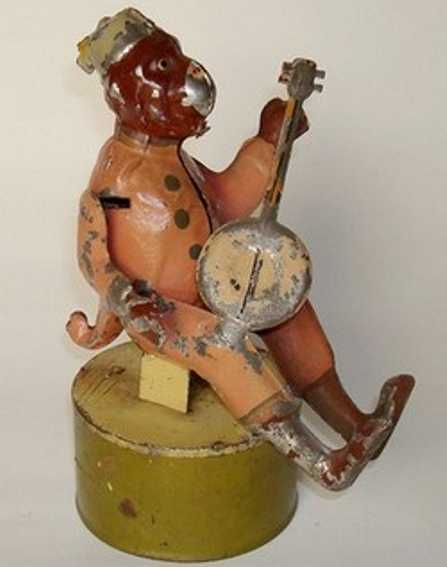 guenthermann monkey in human clothes strums banjo windup toy