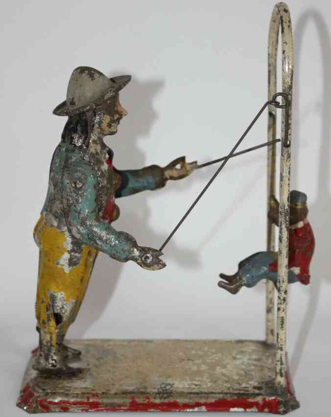 guenthermann tin monkey with trainer wind-up toy