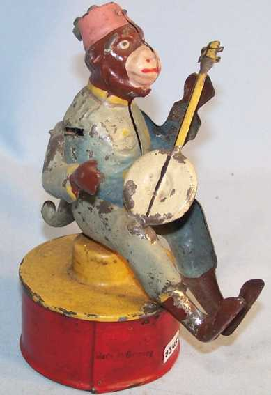 Guenthermann  Monkey with cello and clockwork hand-coated