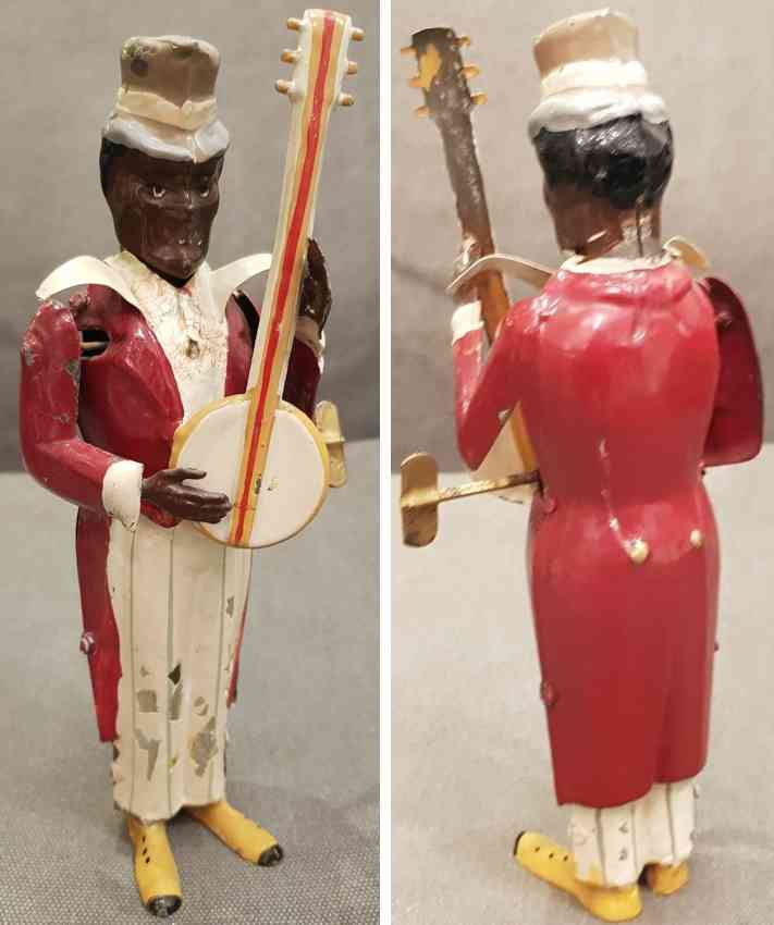 guenthermann tin toy black minstrel red playing banjo with clockwork