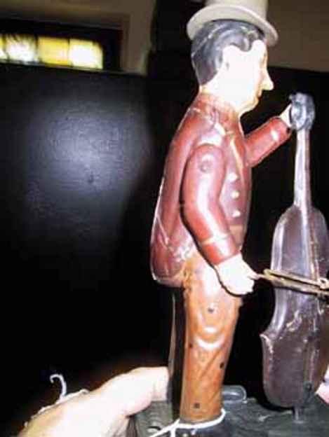 guenthermann blech spielzeug cellospieler uhrwerk