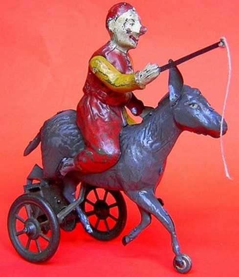 guenthermann tin toy clown on donkey