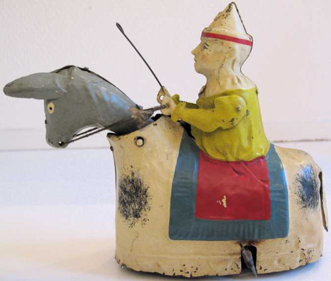 gunthermann tin toy clown on donkey hand-painted clockwork
