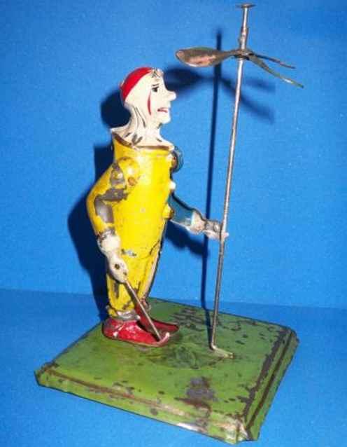 Günthermann Clown hat am linken Arm eine Transmissionswelle