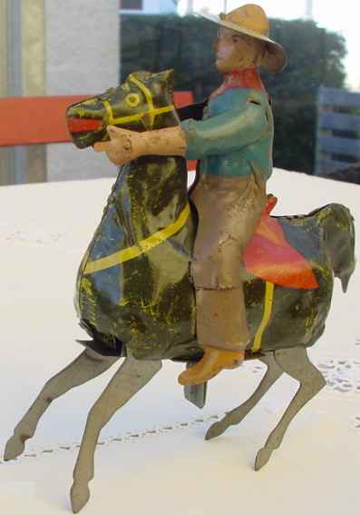 guenthermann tin toy cowboy with horse and clockwork