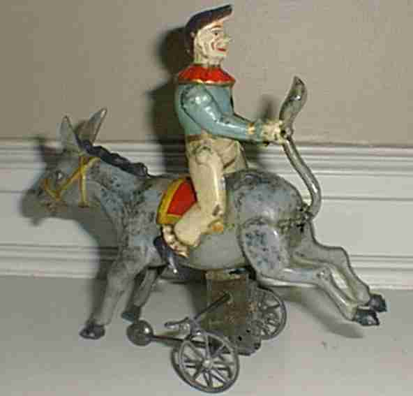 Guenthermann Clown riding a stabborn donkey