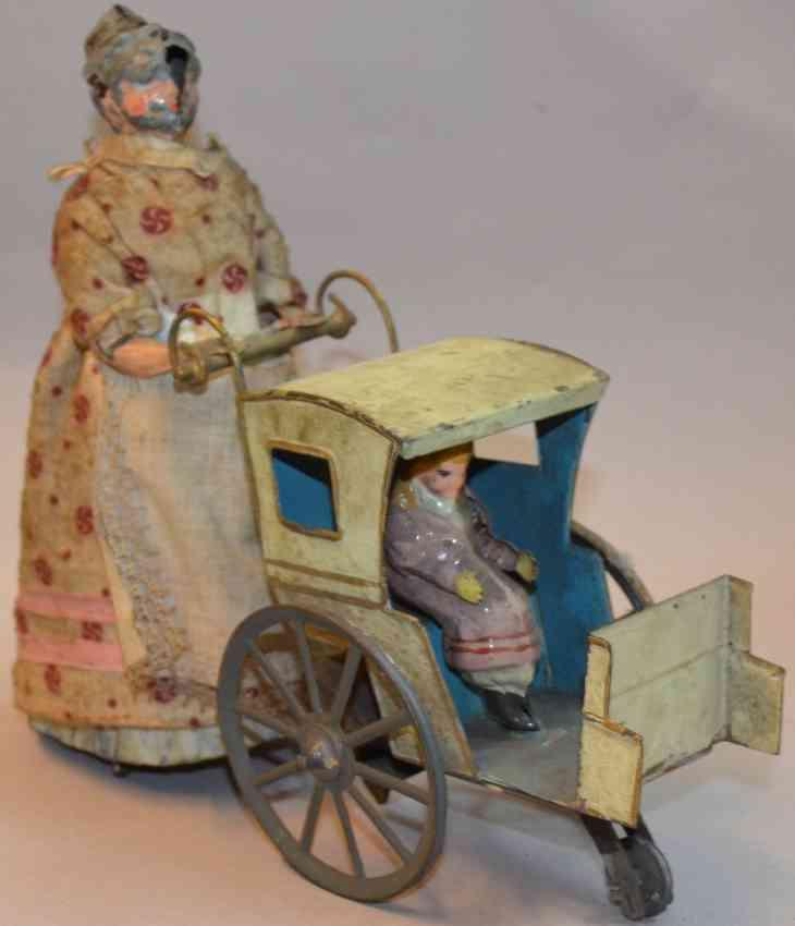 guenthermann tinplate toy woman with pram child clockwork
