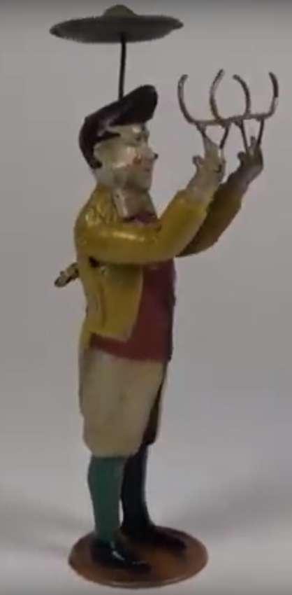 guenthermann blech spielzeug mann als jongleur mit uhrwerk teller ball