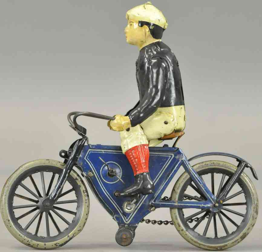 guenthermann tin toy boy riding bicycle