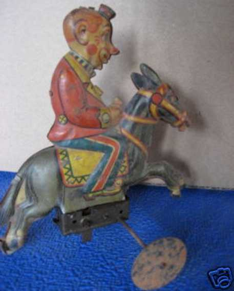 Guenthermann Clown straddling a donkey