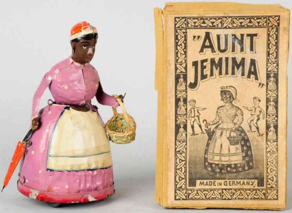 gunthermann blech spielzeug figur tante jemima mit uhrwerk frau mit korb