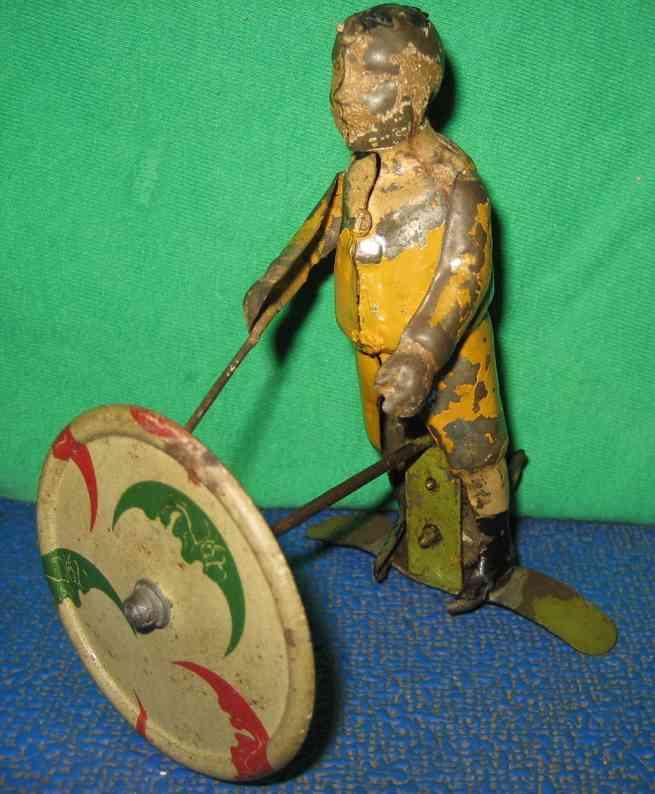 guenthermann blech spielzeug mann mit zeiger an scheibe mit uhrwerk, handbemalt mit litho