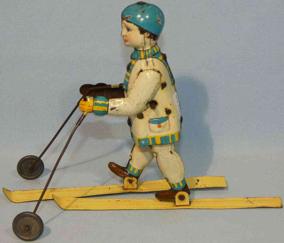 hammerer & kuhlwein tin toy skier with clockwork