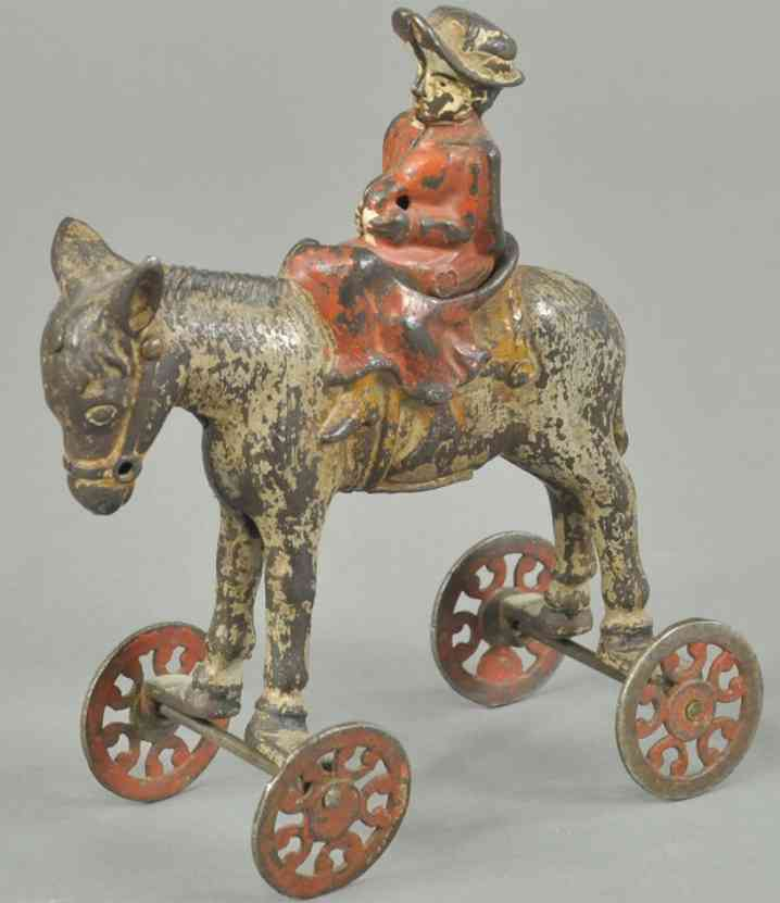 us hardware co cast iron toy girl on horse