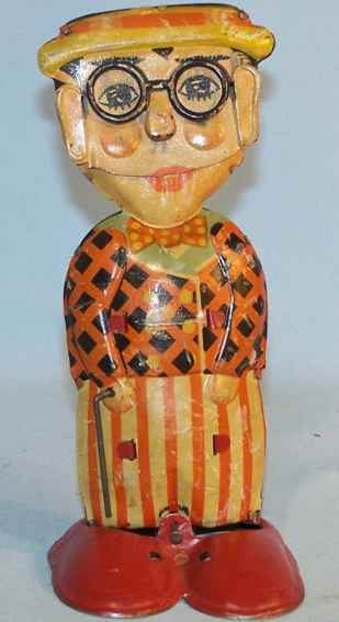 herold lloyd tin toy lithographed figure, dance and swing his walking stick
