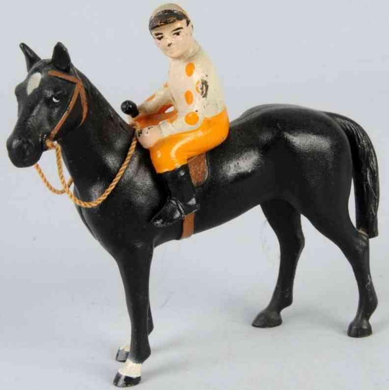 hubley spielzeug gusseisen pferd mit jockey als briefbeschwerer