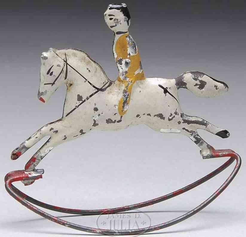 hull & stafford tin boy on horse rocking toy