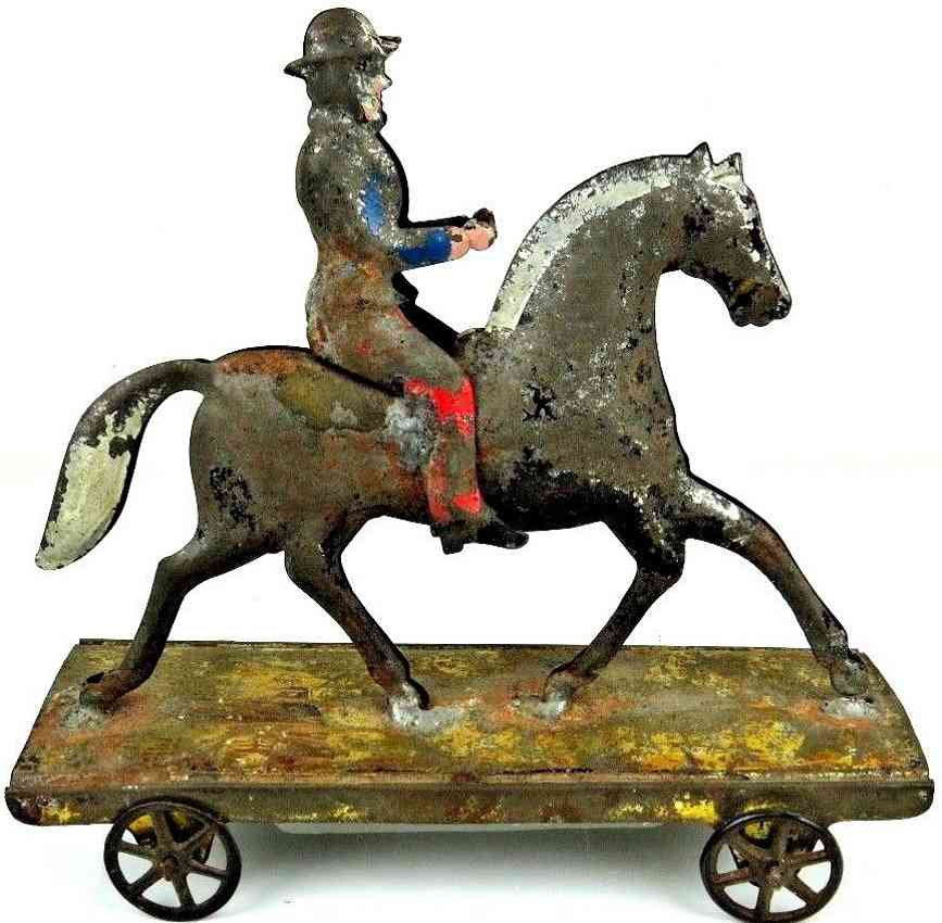 hull & stafford tin toy horse with rider on platform as pull toy