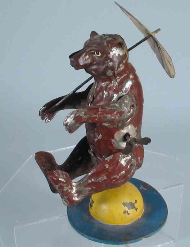 Issmayer Balancing and spinning bear with umbrella