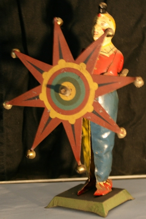 issmayer tin toy clown with star and clockwork stick