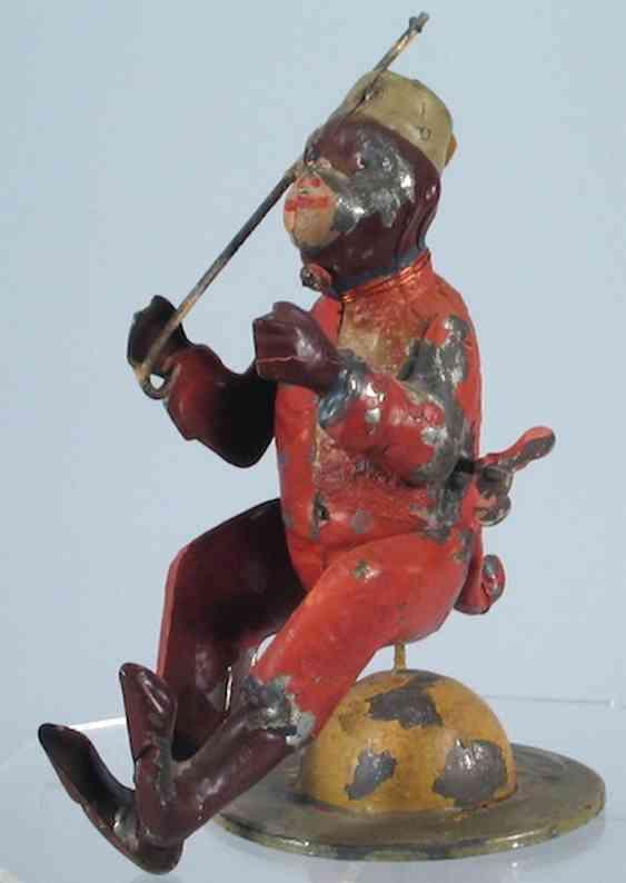 Issmayer Monkey balancing and spinning on globe