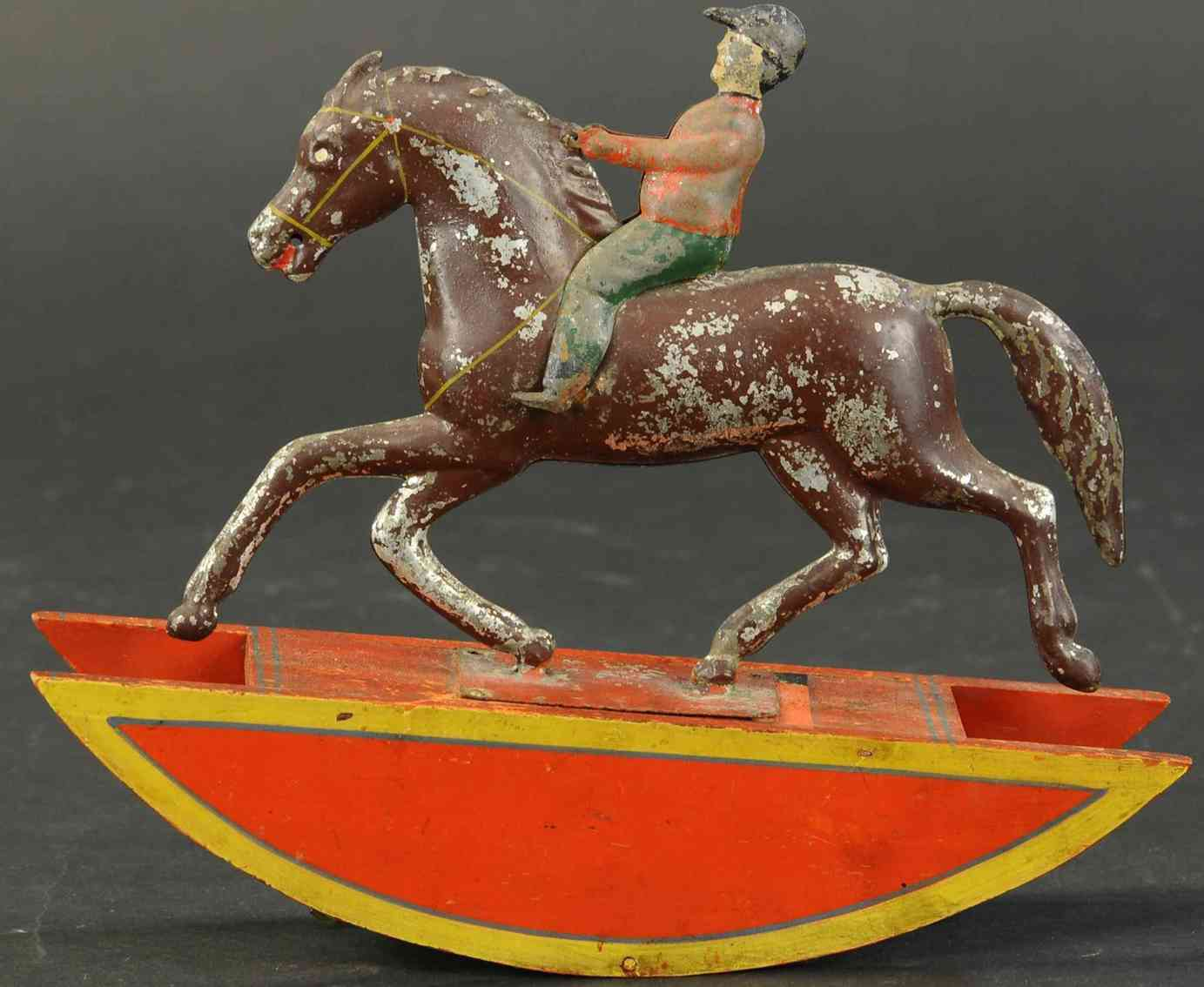 ives tin toy rocking horse with decorated wooden base rider