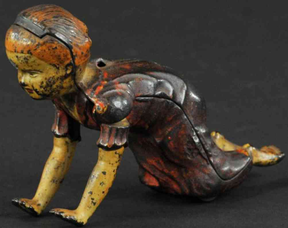 ives cast iron toy figure crawling baby