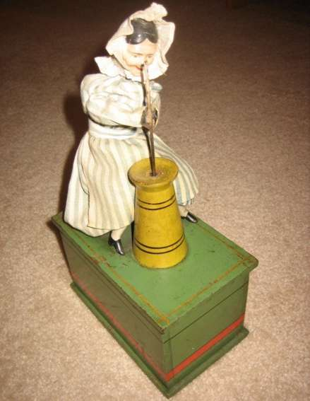 ives tin toy old lady with butter churn clockwork