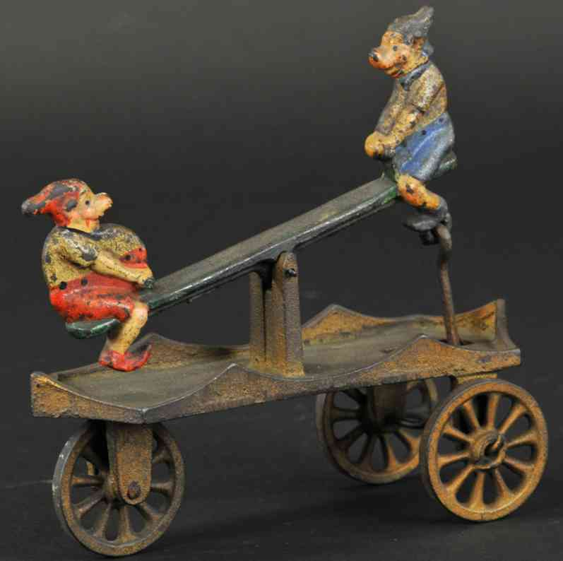 kenton hardware co cast iron toy elves see-saw bell toy