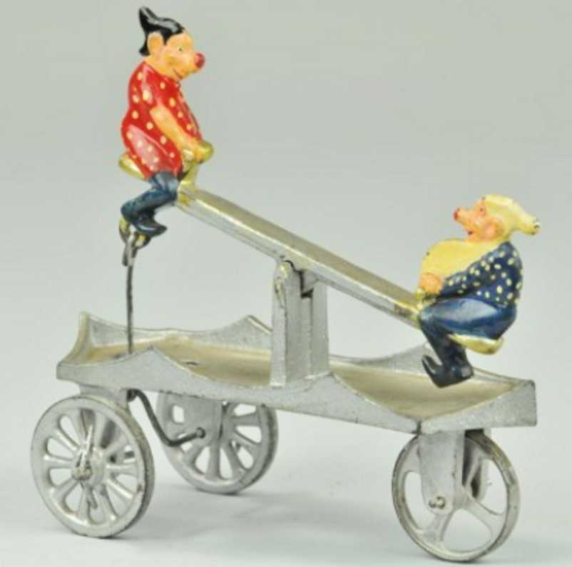 kenton hardware co cast iron toy elves see-saw bell toy silver