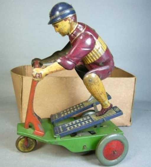 Meiji Scooter mit Figur aus Blech