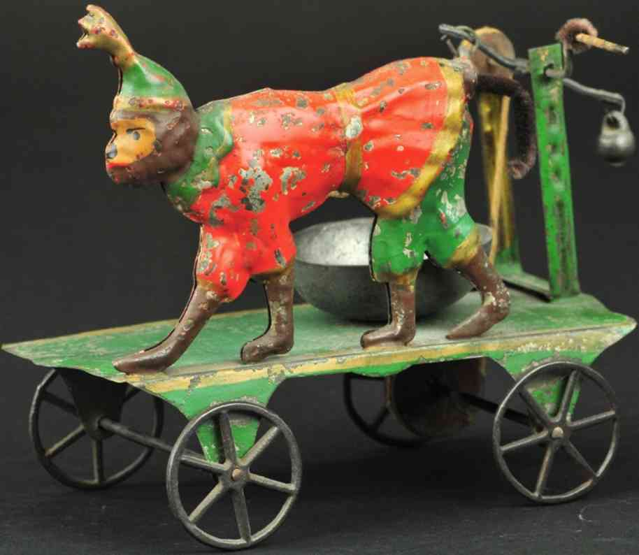 merriam cast iron toy monkey on platform as bell toy
